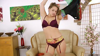 Olga Cabaeva removes her clothes to pleasure her wet snatch