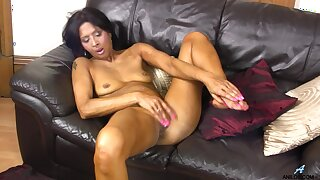 Ebony slut Sophia Smith opens her legs to masturbate on the sofa