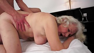 A fat granny is getting her pussy destroyed by a young dude