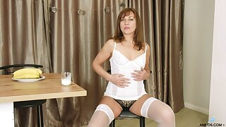 Sex-appeal older woman Rafaella shows striptease and plays with pussy