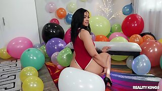 Bold brunette Bad Kittyyy gets busy in a balloon-filled room