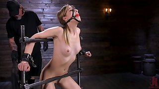 Tied up porn model Kristen Scott gets her pussy toying in the dark BDSM room